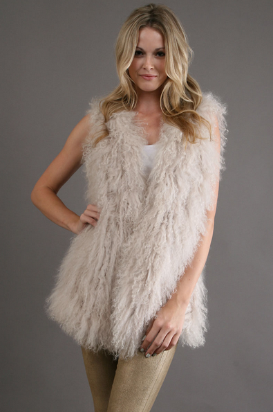 This textured Lilya Wilderness Vest in Shell ($438) will bring a soft Winter white touch to every look.
