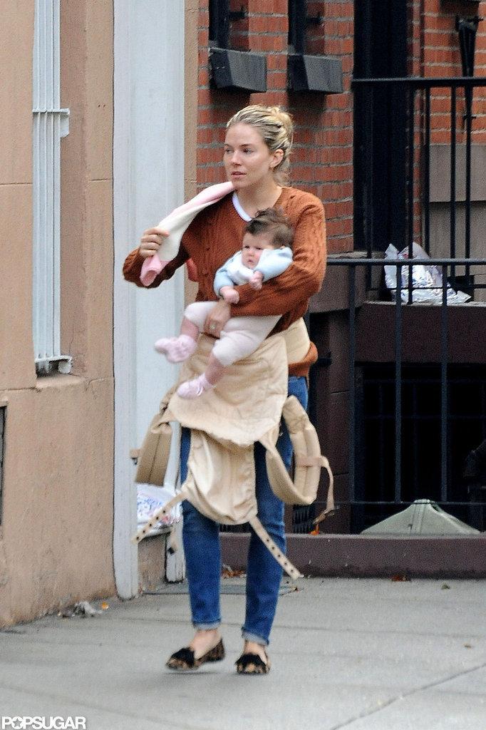 Sienna Miller held Marlowe in her arms.