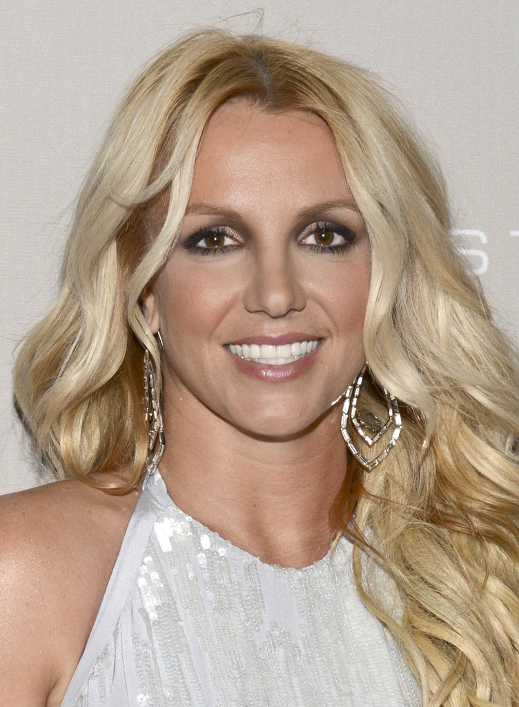 Britney Spears chose a high beaded neckline and statement earrings for the event.