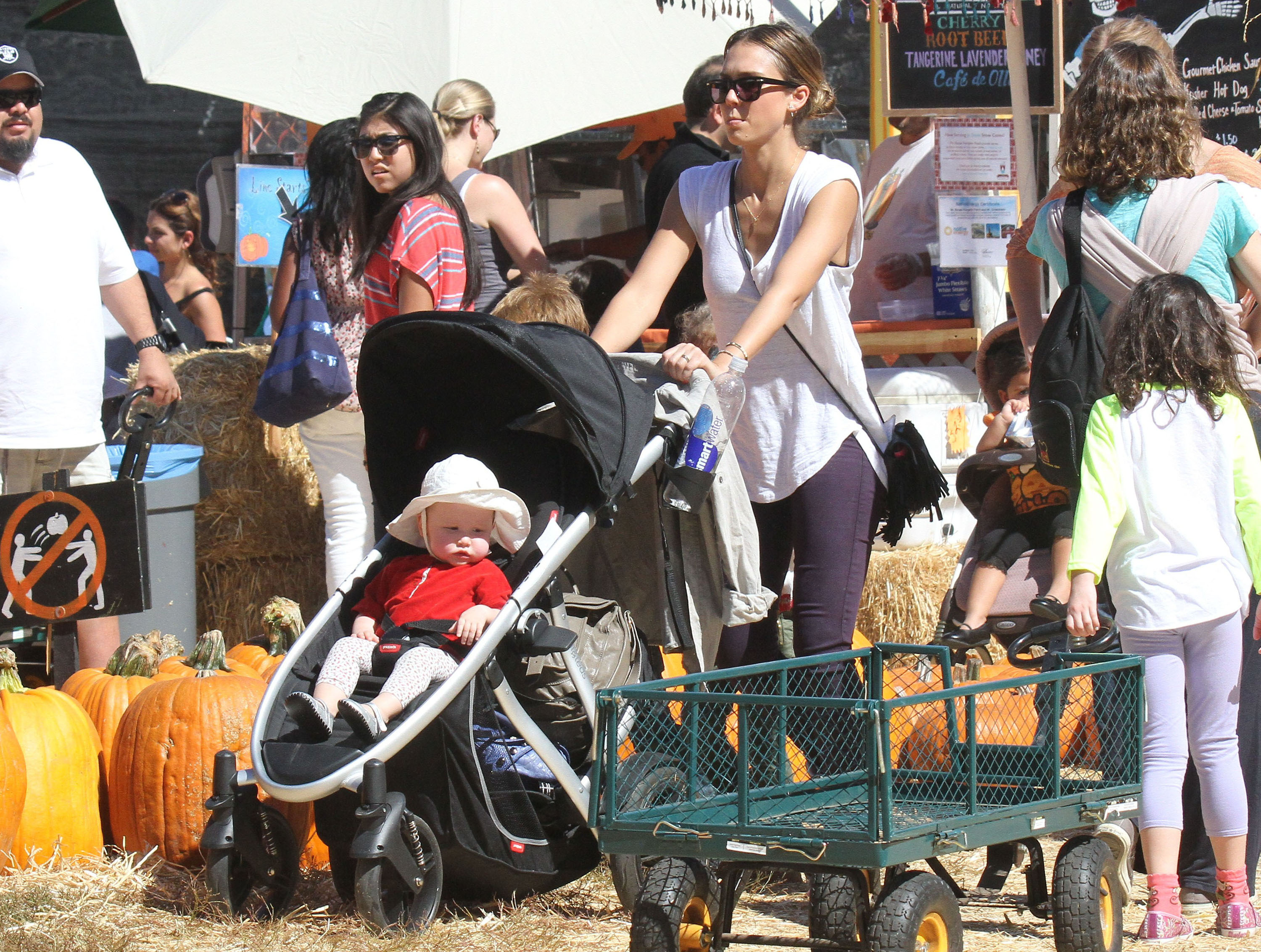At Mr. Bones Pumpkin Patch in LA, Jessica Alba pushed baby Honor through the pumpkins in her stroller.
