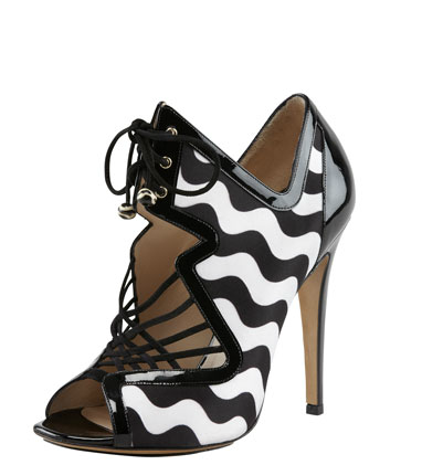 Inject a playful note into your lace-up agenda via this Nicholas Kirkwood sandal ($1,090). It's a bold (and colorblocked) testament to the designer's quirky charm and your penchant for whimsical prints.