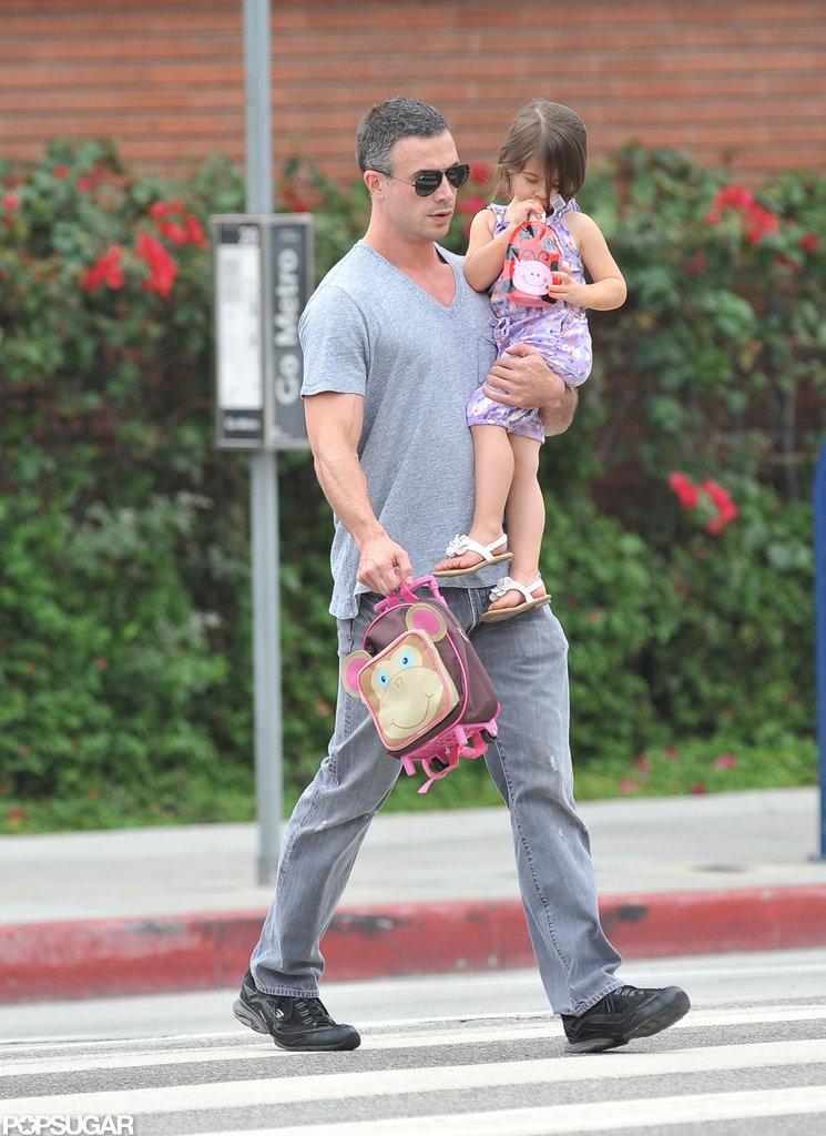 Freddie Prinze Jr. carried his daughter Charlotte.