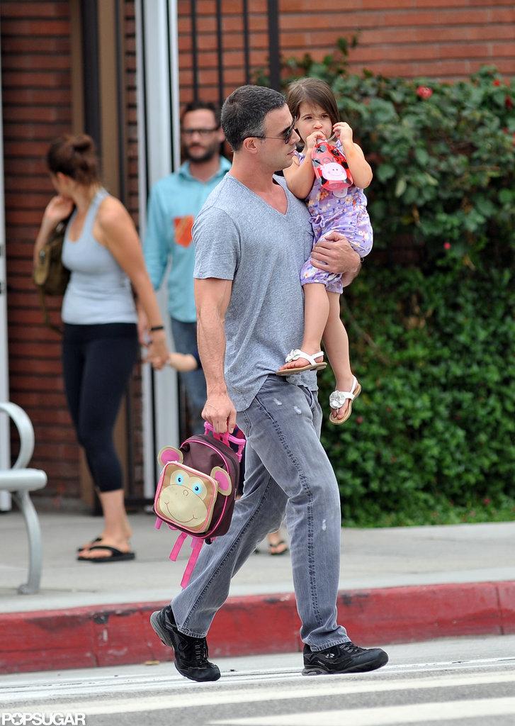 Freddie Prinze carried his daughter Charlotte to her school.