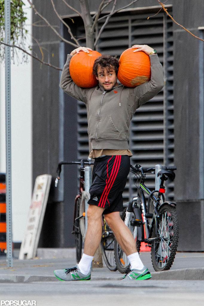Hugh Dancy balanced two pumpkins on his shoulders in Toronto.