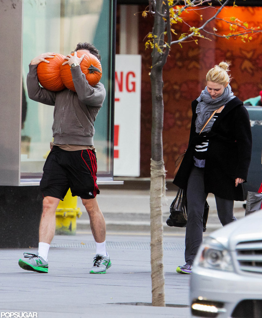 Claire Danes followed behind husband Hugh Dancy who carried two large pumpkins down the street.