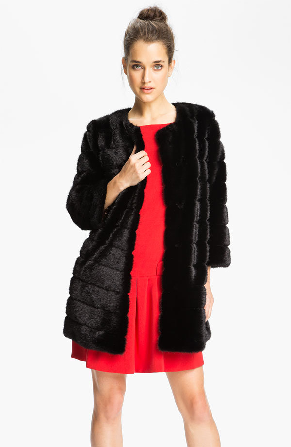 Sam Edelman's Faux Fur Walking Coat ($200) was made to be worn over cocktail dresses, so be sure to throw it on for a night on the town.