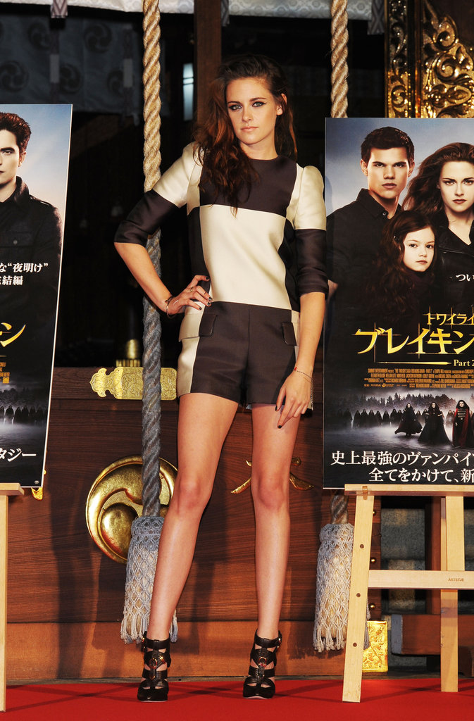 Kristen Stewart posed for photos with Breaking Dawn — Part 2 posters in Japan.
