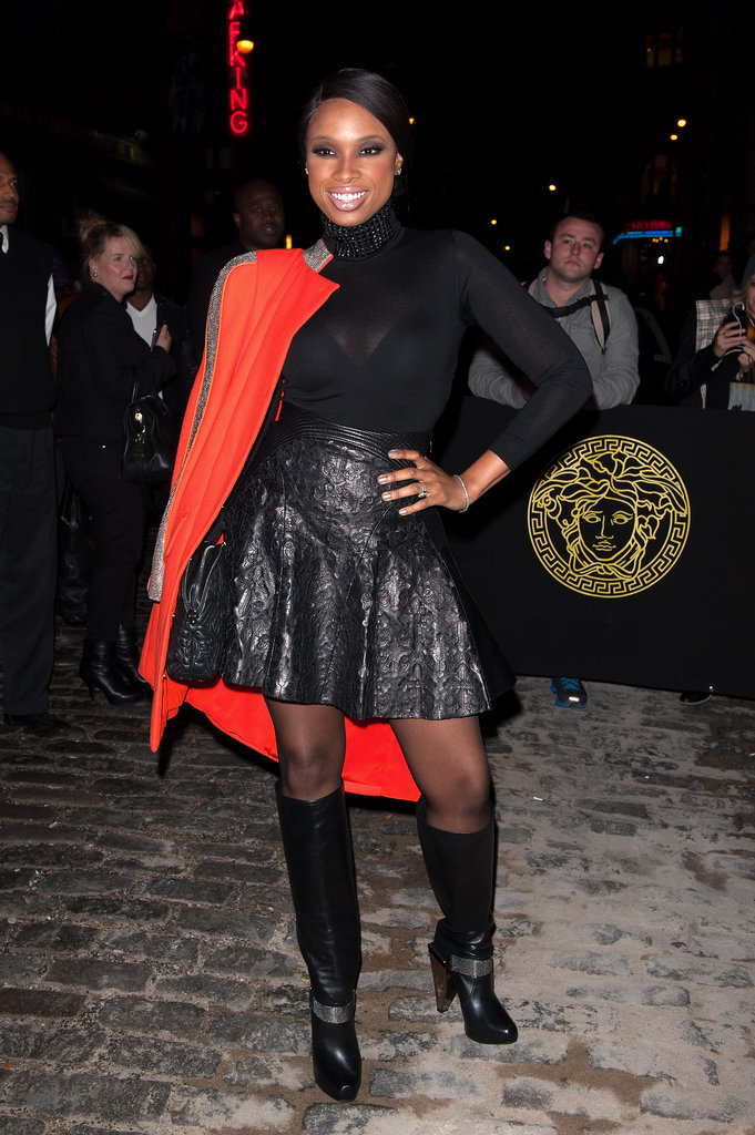 Jennifer Hudson opted for a high-impact colour contrast, adding a bright orange coat to her all-black ensemble.
