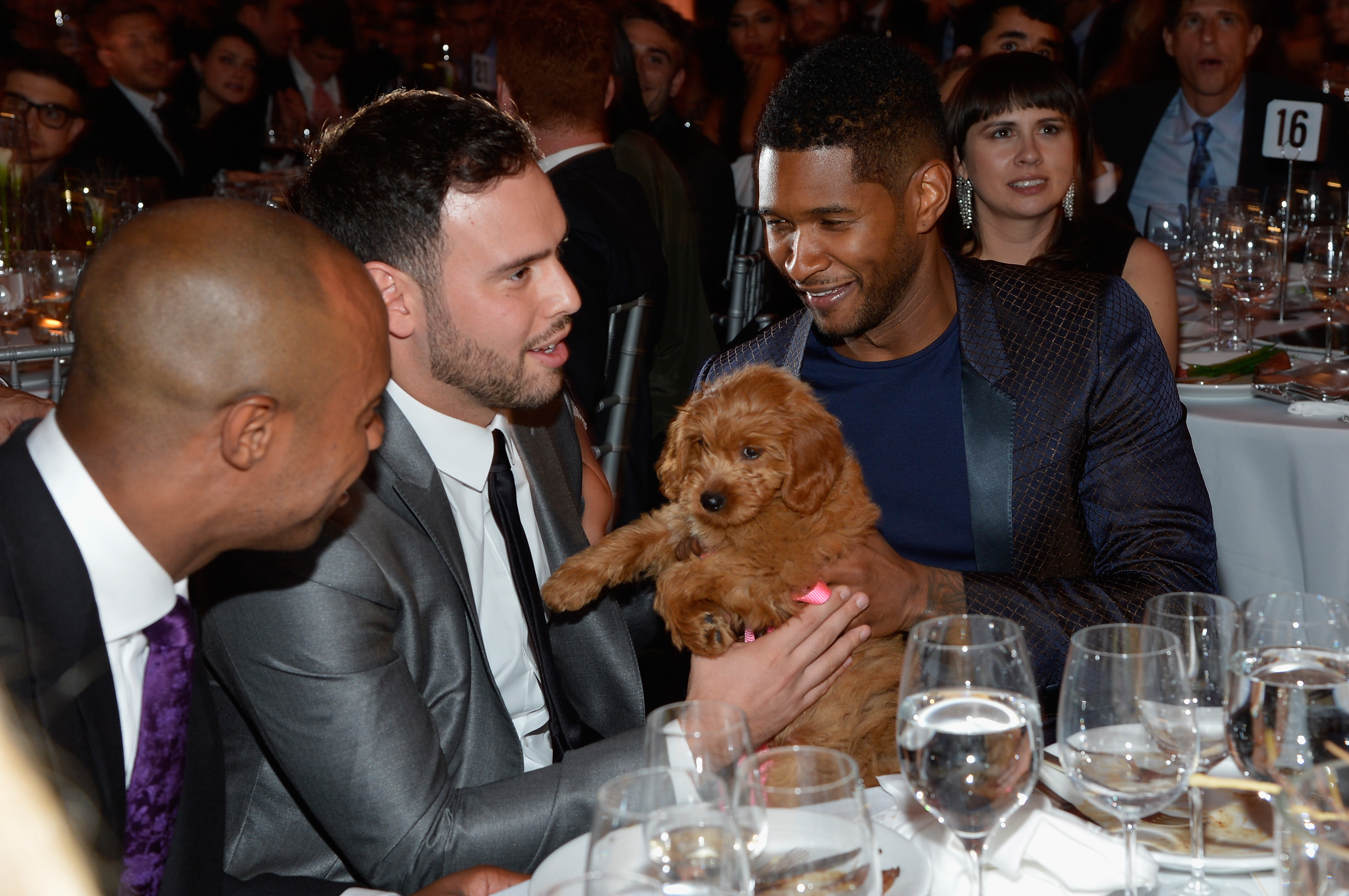 Usher let Scooter Braun hold his new puppy.