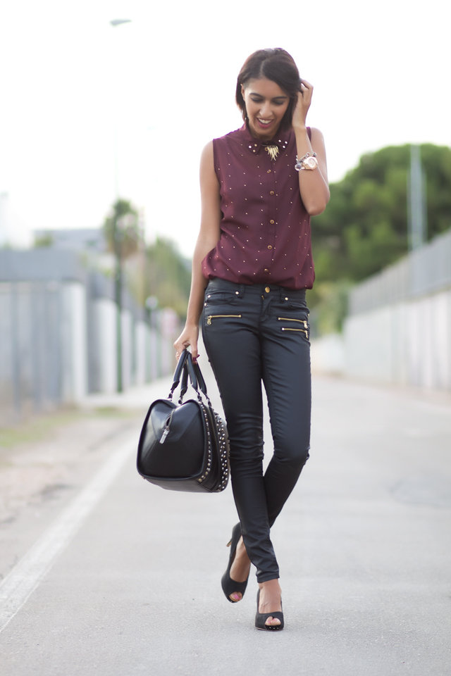 Slick leather bottoms transform a feminine blouse with a tougher, on-trend feel. Source: Lookbook.nu