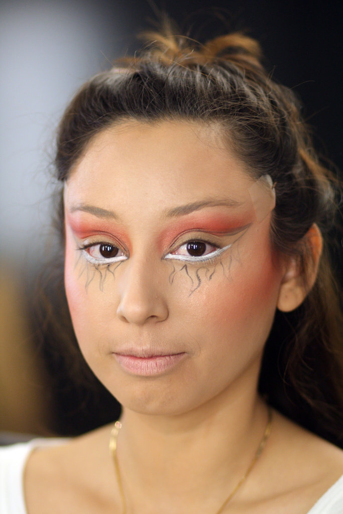 To bring a fiery flush to the face, Zizzo applied Acid Orange pigment on the cheeks, moving the color up toward the temples. Along the waterline, she applied Eye Kohl ($16) in Fascinating.