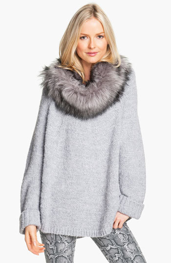 Yes, this Michael Kors faux fur trim poncho sweater ($150) comes with a detachable faux fur loop scarf. How amazing is that?