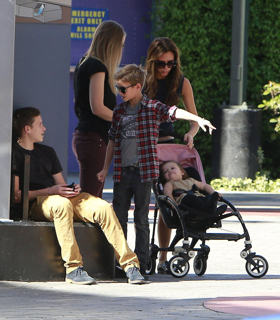 Victoria Beckham took Harper and her boys shopping in Universal City.