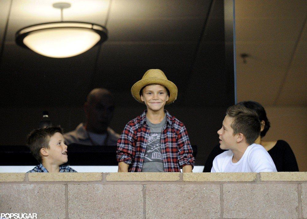 Romeo Beckham, Cruz Beckham, and Brooklyn Beckham sat together at David Beckham's soccer game.