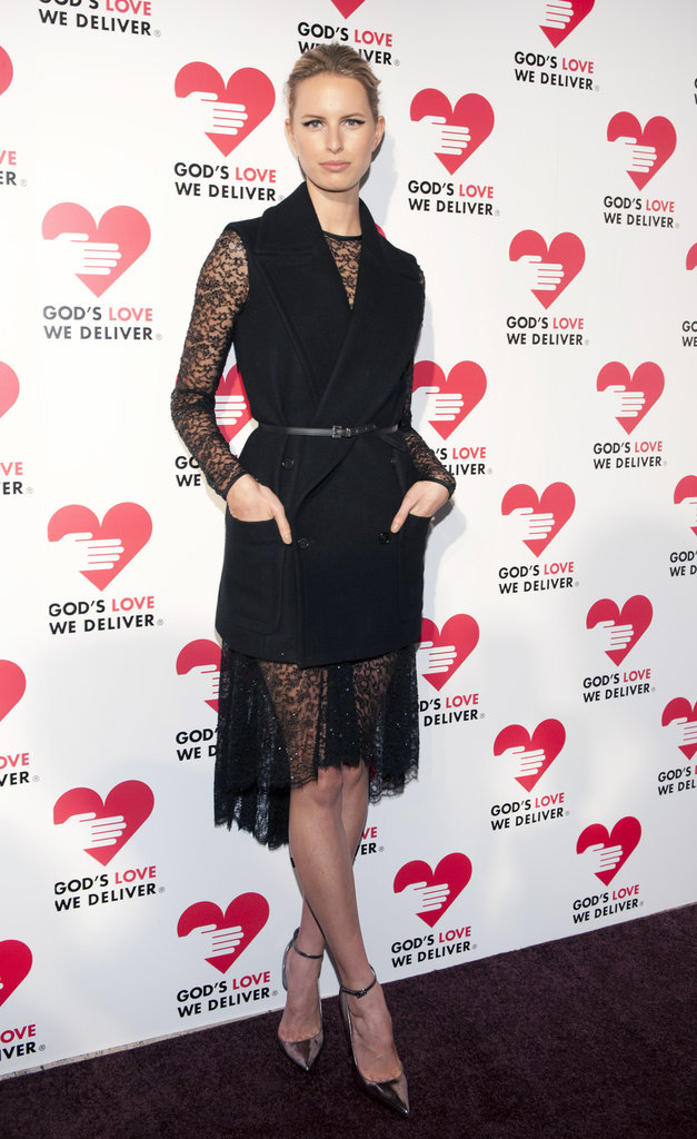 Karolina Kurkova warmed up her Chantilly lace dress with a wool vest.