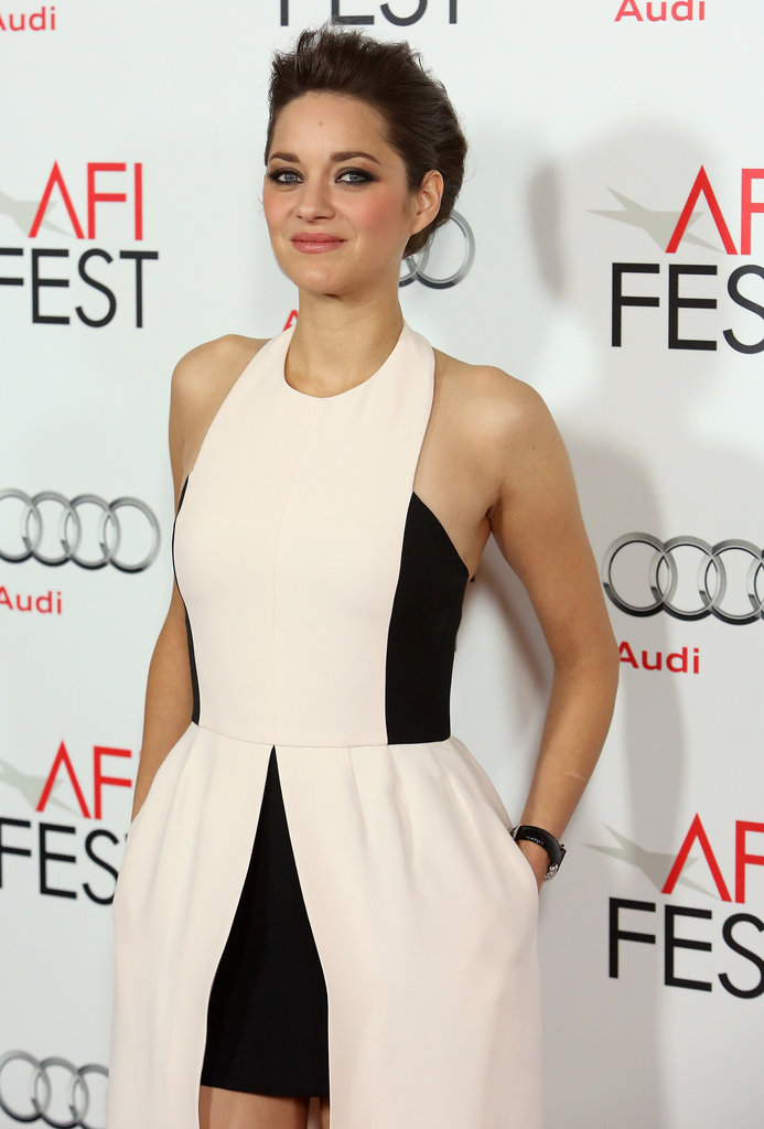 Marion Cotillard tucked her hands in her pockets on the red carpet.