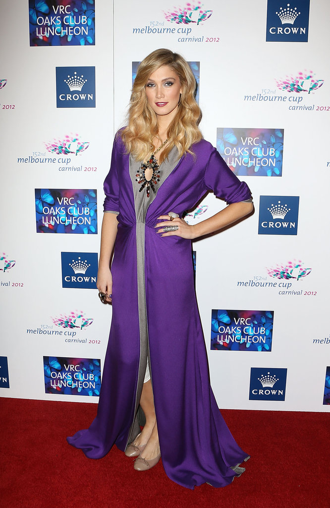 Delta Goodrem struck a pose in purple at the VRC Oaks Club Luncheon in Melbourne before performing for guests at the event in Nov. 2012.