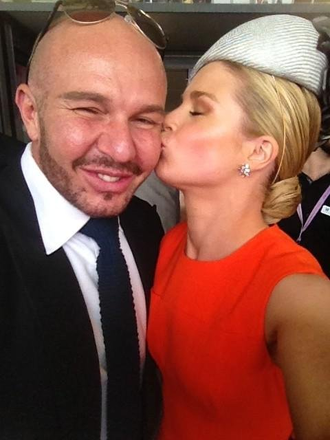 Lucky Alex Perry scored a kiss from Emma Freedman at the Melbourne Cup. Source: Twitter user alexperry007