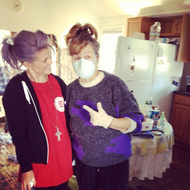 Kelly Osbourne shared a laugh with a woman while helping clean her home after Hurricane Sandy. Source: Instagram user kellyosbourne