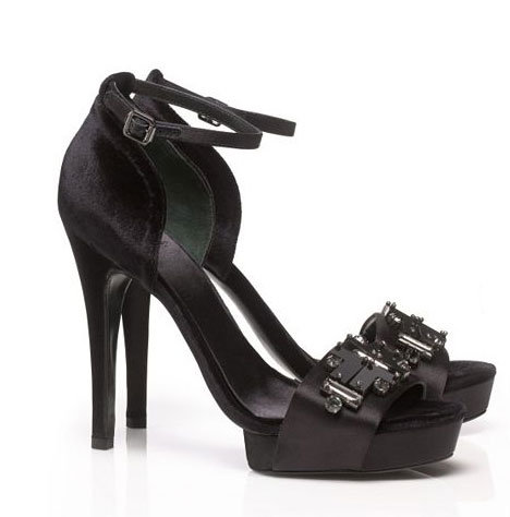 We'd wear these Tory Burch Viola Satin and Velvet Sandals ($425) with black tights to lengthen our stems.