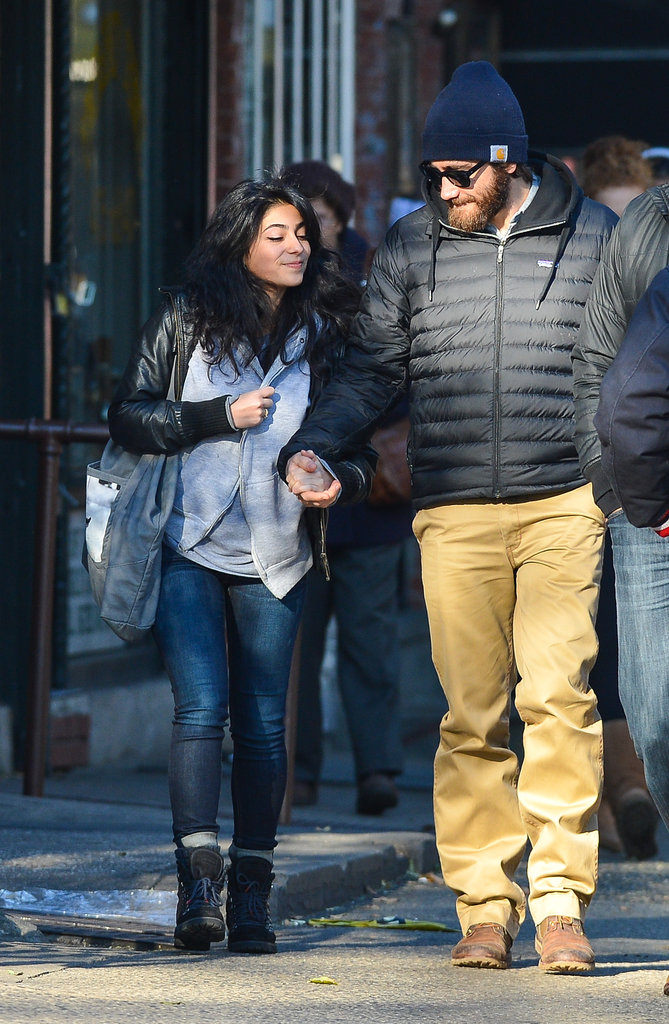 Jake Gyllenhall showed off his mysterious new girlfriend as they held hands walking around the East Village in New York on November 9.