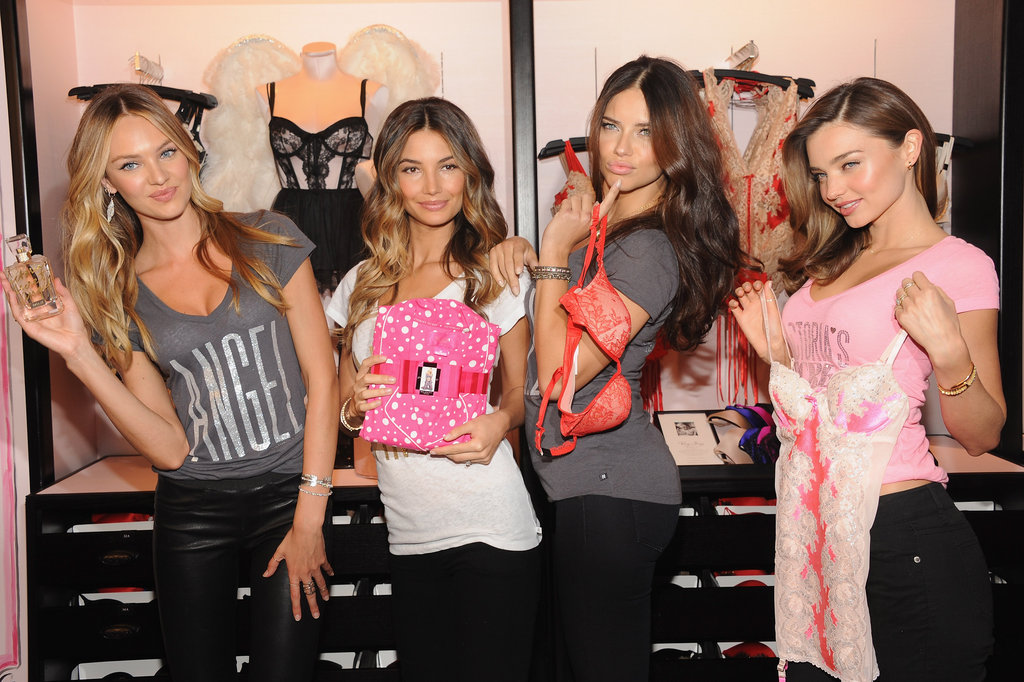Miranda Kerr, Lily Aldridge, Adriana Lima, and Candice Swanepoel showed off their holiday gear together at Victoria's Secret Herald Square in NYC.