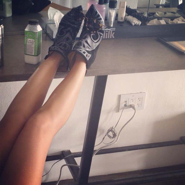 Miranda Kerr and her fabulous pins flaunted some amazing boots as she had her hair and makeup done. Source: Instagram user mirandakerrverified