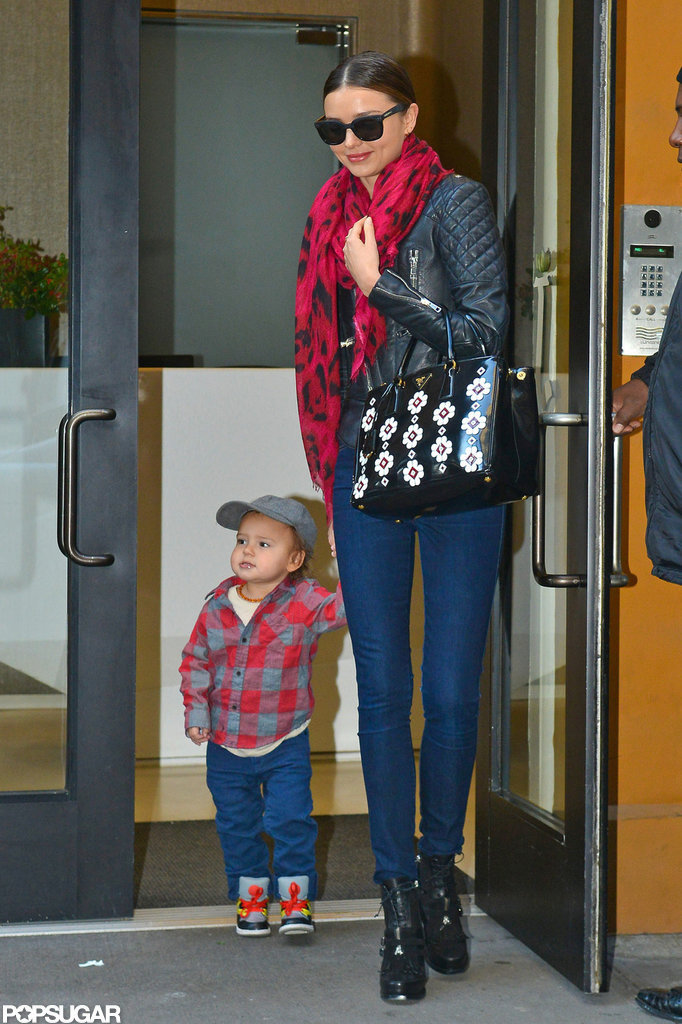 Miranda Kerr held Flynn Bloom's hand as they walked out of an NYC building.