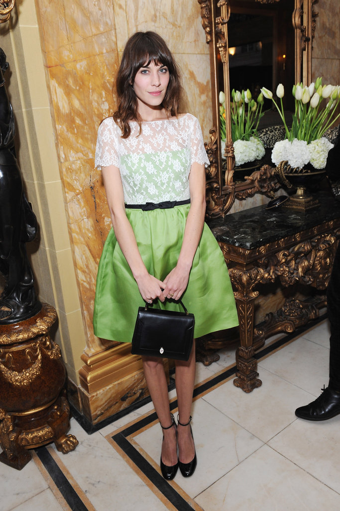 Alexa Chung wore a green and lace dress at the-miumiu-london day two.