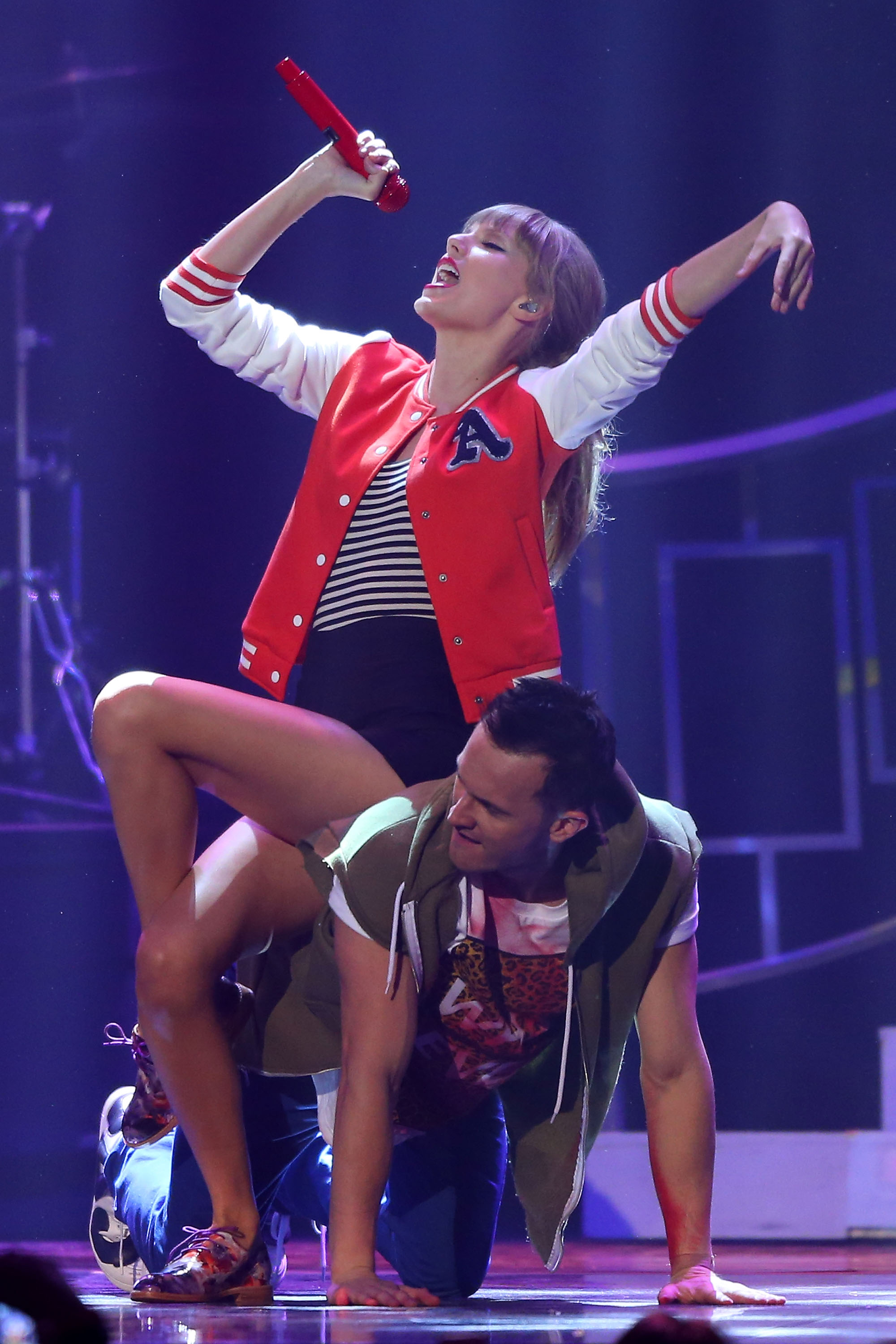 Taylor Swift performed in a red and white varsity jacket.