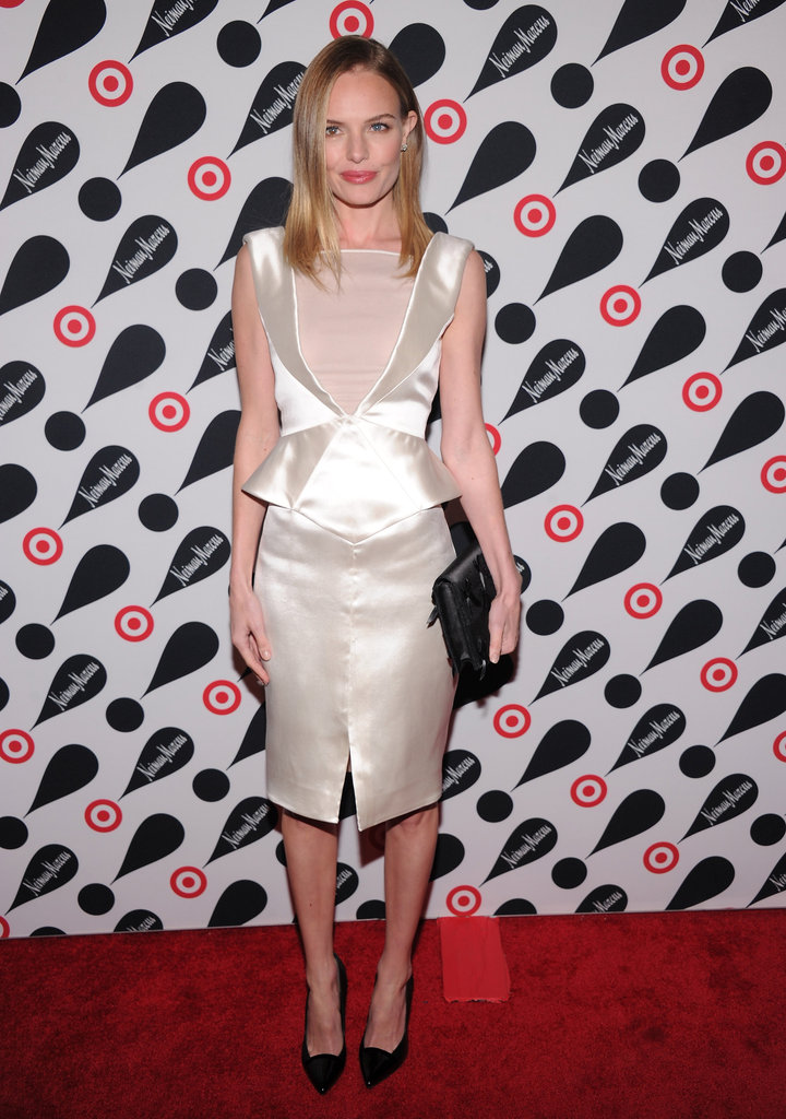 Kate Bosworth made her entrance in a white stain, peplum-trimmed Pucci with a sheer inset at the neckline.