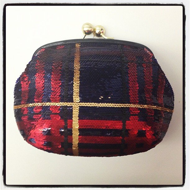 How perfect for the holidays is this Coach clutch?