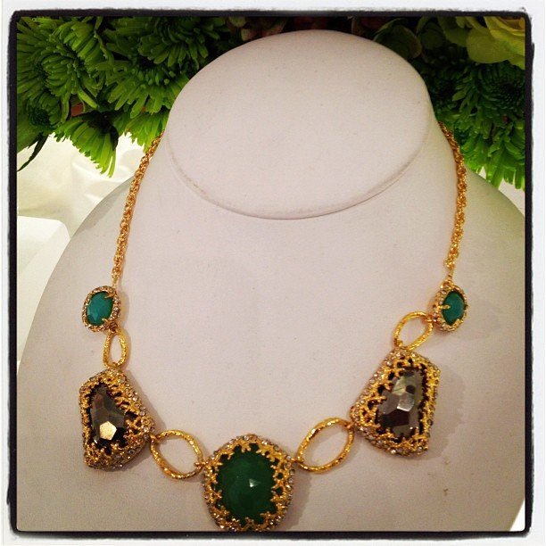 How beautiful is the gold detailing of this Alexis Bittar necklace against the gray and green stones?