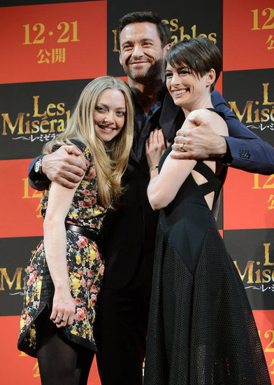 Amanda Seyfried, Hugh Jackman and Anne Hathaway made a close-knit team as they made a press stop for their new film, Les Misérables, in Tokyo on November 28.