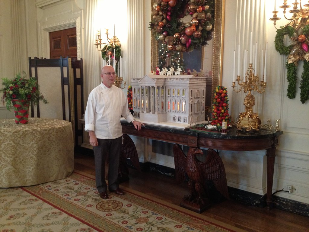 Chef Bill Yosses posed alongside his creation.
