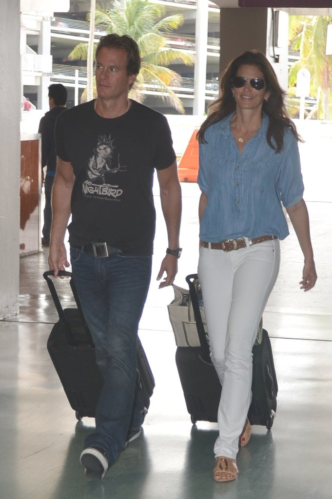 Cindy Crawford's mix of white denim and a chambray shirt ensures she's chic, without trying too hard.