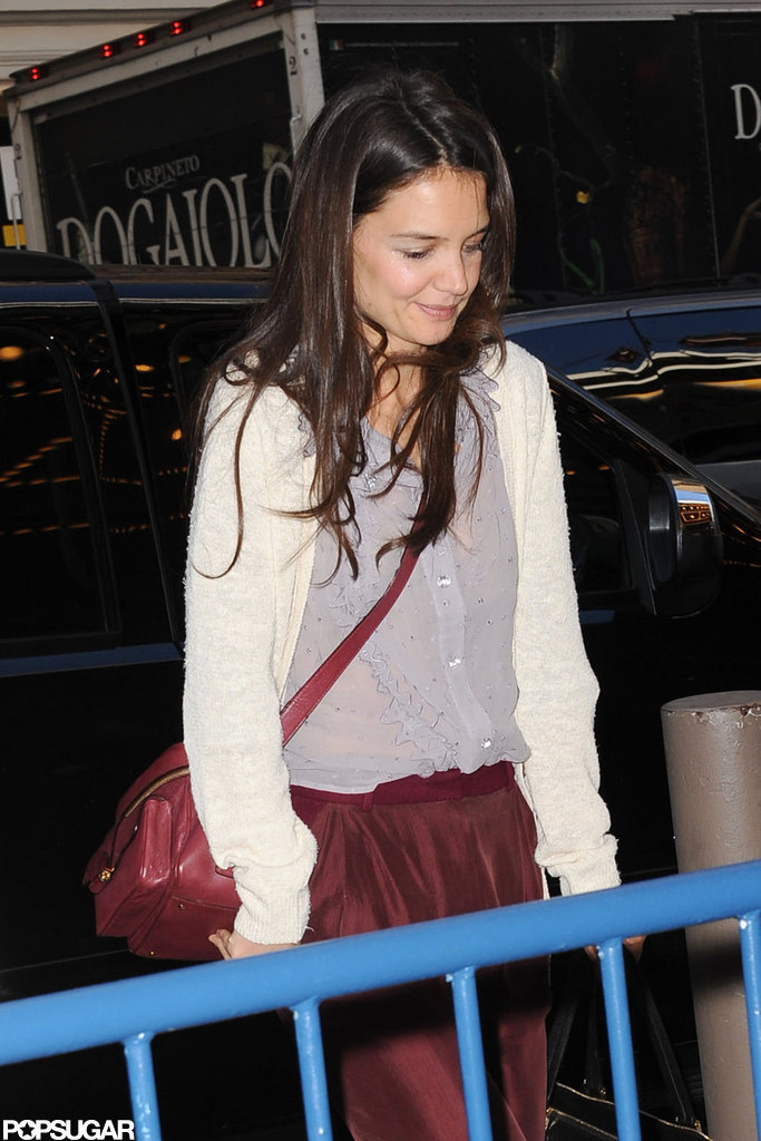 Katie Holmes tucked her hands in her pockets as she made her way inside.