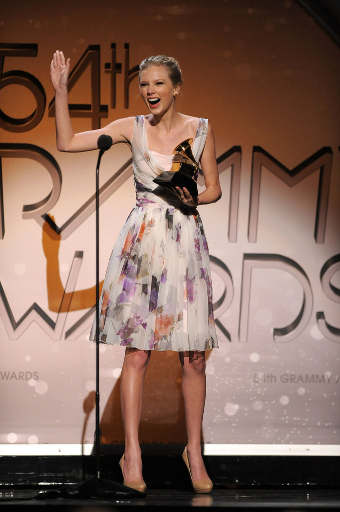 Taylor Swift celebrated her Grammy win backstage in the press room in February 2012.