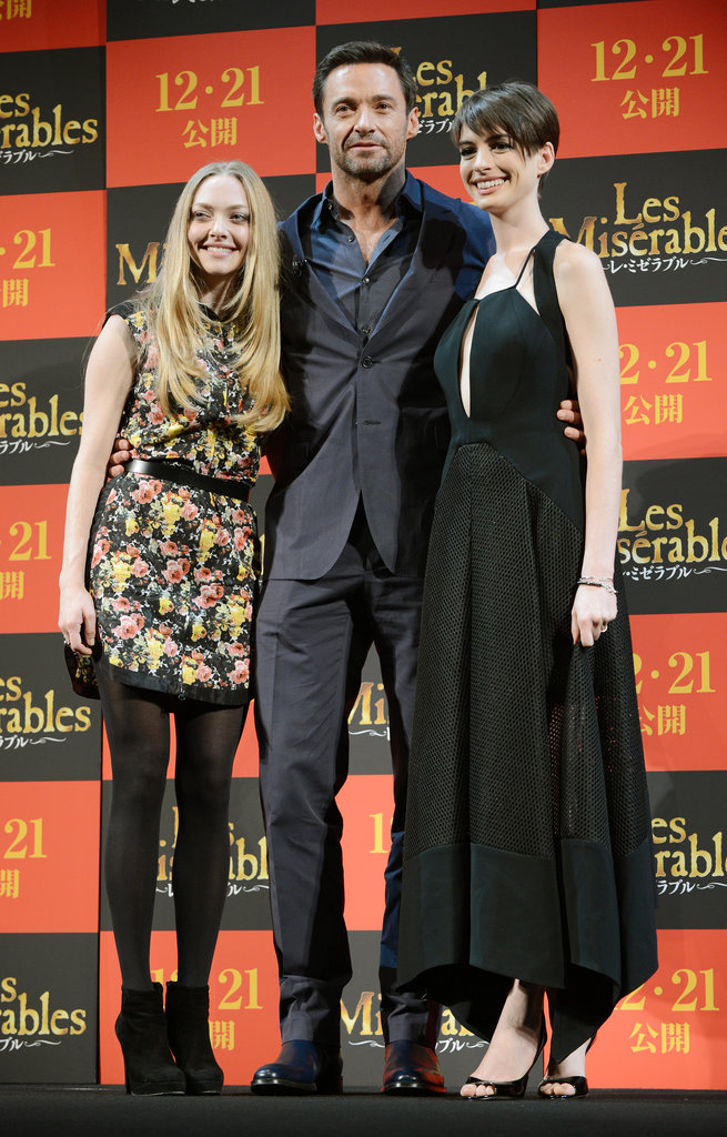 Amanda and Anne both flanked costar Hugh Jackman at the film's Tokyo premiere. Amanda gave a floral Brood dress a Winter makeover with black tights and booties; Anne took the retro-inspired glam route in a fit-and-flare Antonio Berardi.