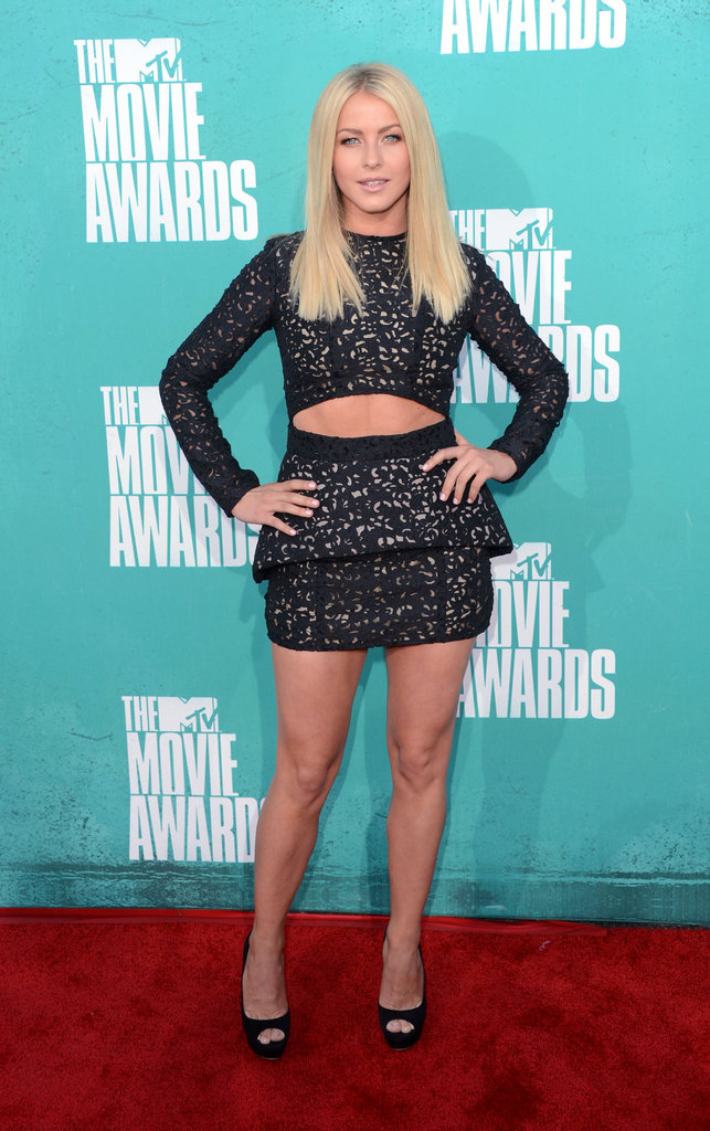 Julianne Hough showed off her legs — and her abs — in a black peplum Sally LaPointe minidress in June.