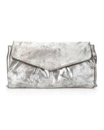 A cool metallic handbag like this R&J folded pleat clutch ($23, originally $58) looks way more luxe than its price tag suggests — and will go with any of your holiday outfits.