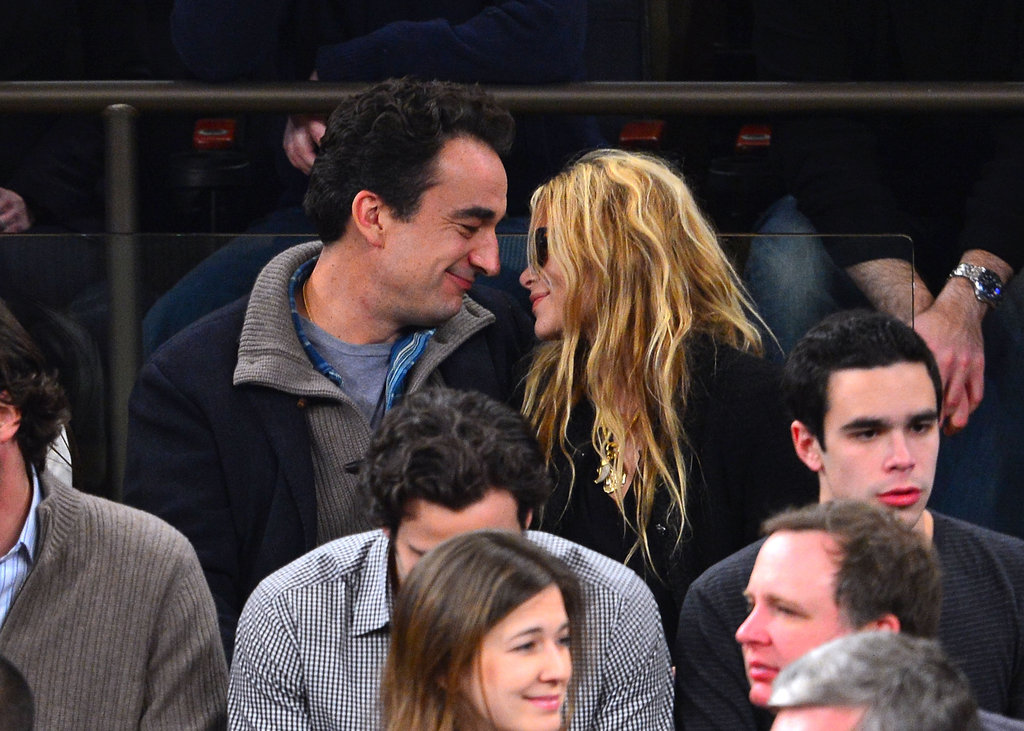 Mary-Kate Olsen and her new boyfriend were affectionate at the game.