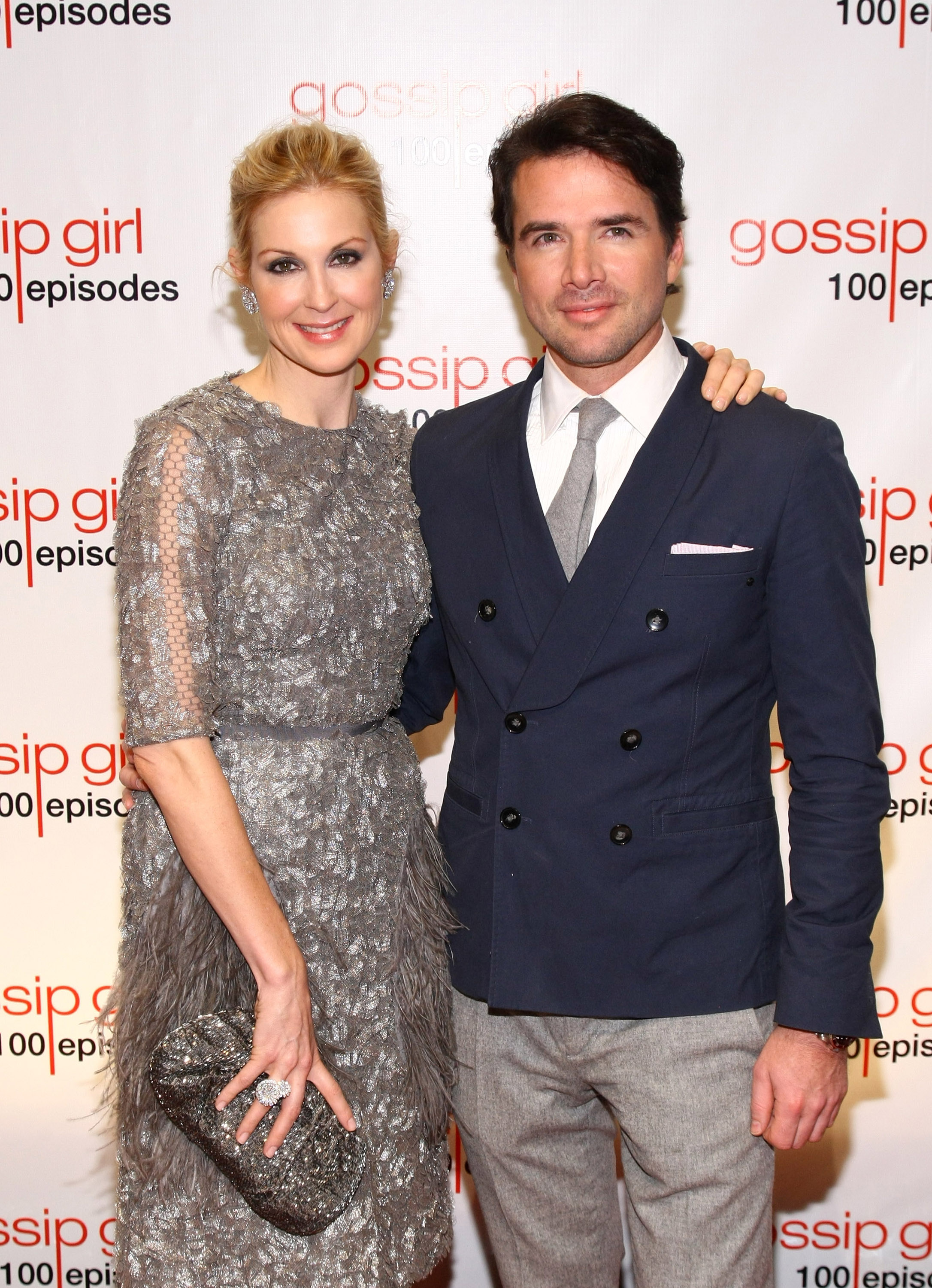 Gossip Girl costars Kelly Rutherford and Matthew Settle snapped a photo arriving at the show's 100th episode celebration in November 2011.