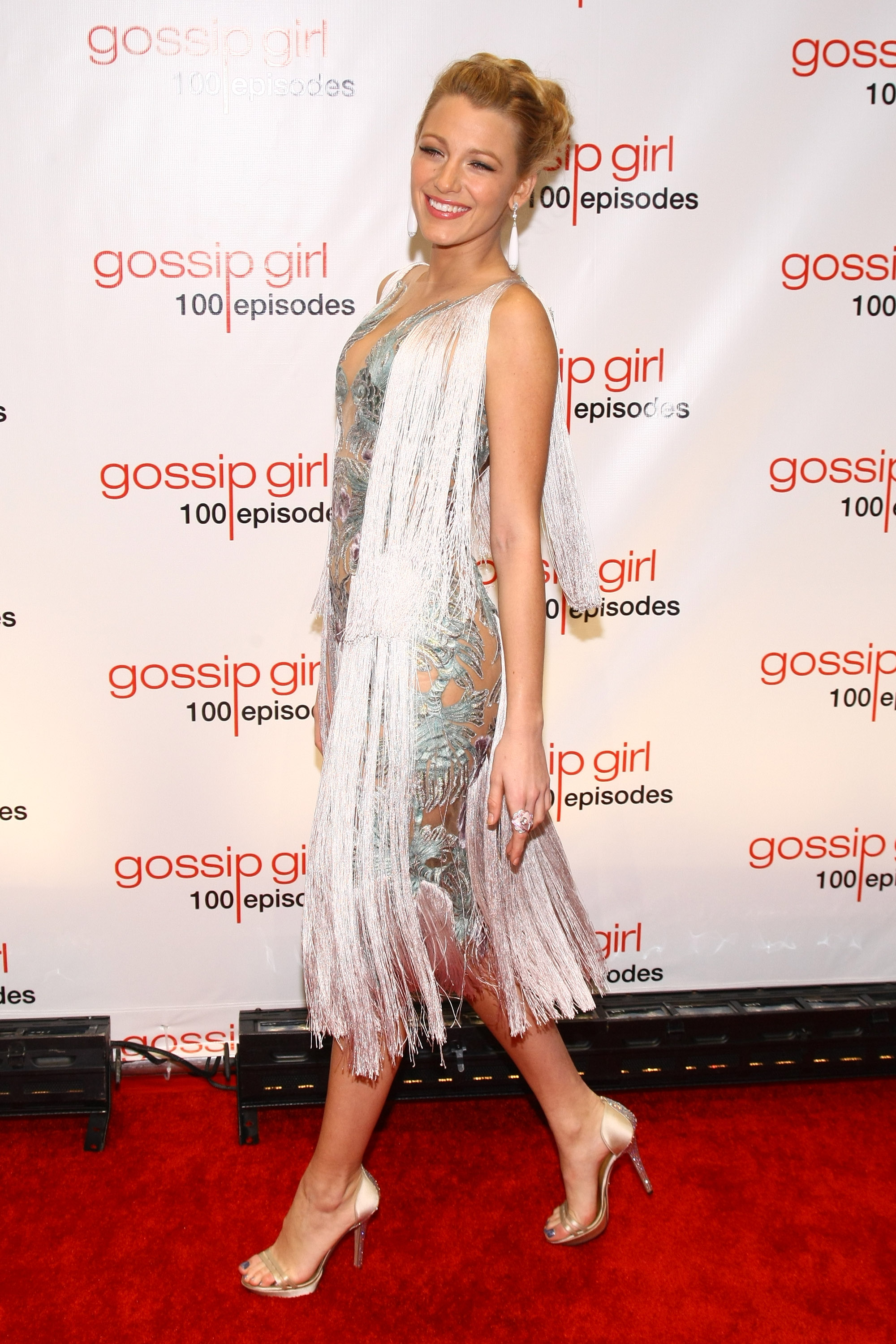 Blake Lively hit the red carpet solo for the show's 100th episode celebration in November 2011.