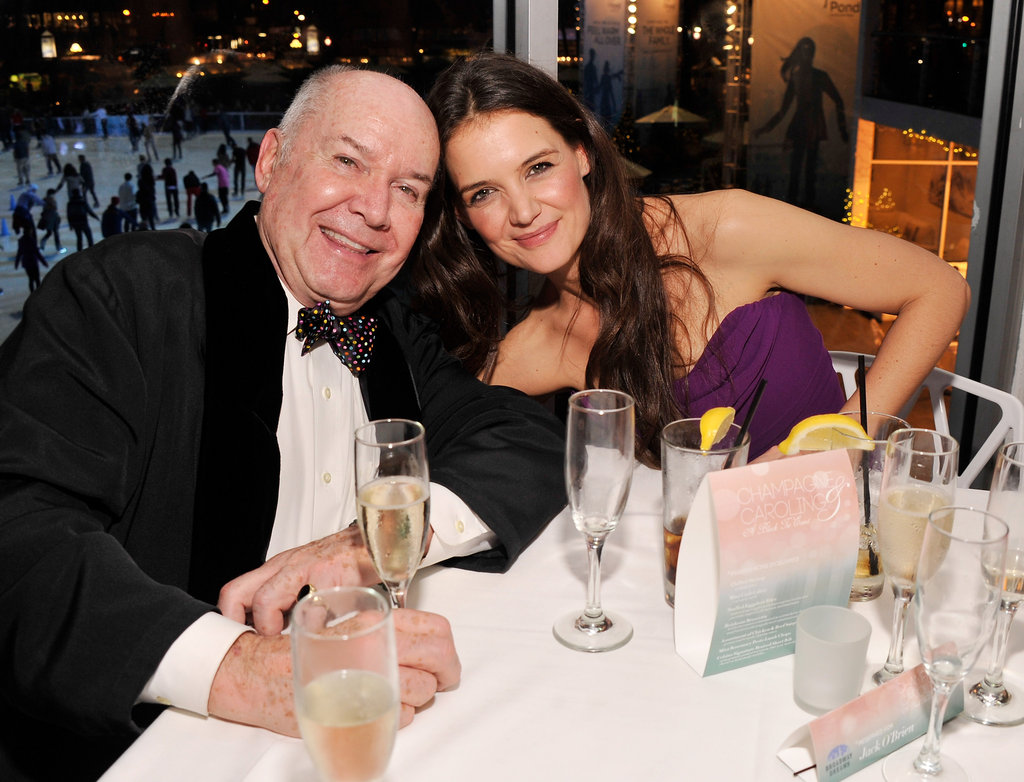 Producer and writer Jack O'Brien stuck close to friend Katie Holmes on December 10, when they both attended a Broadway Christmas bash in NY.