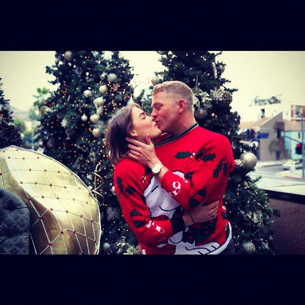 Model Bambi and her boyfriend, designer Dan Single got into the Christmas spirit with a shared jumper and a kiss. Source: Instagram user stefbambi_