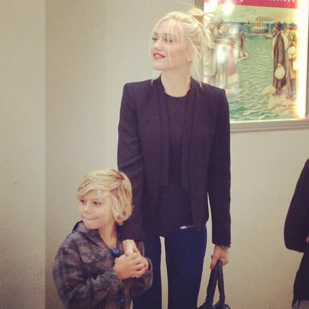 Gwen Stefani held hands with her oldest son, Kingston Rossdale, at the Milk and Bookies event, while Zuma was too shy to walk the carpet with them.