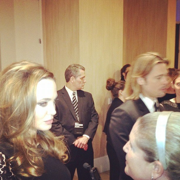 Angelina Jolie and Brad Pitt were swarmed by press, but we managed to snap a photo of the A-list couple at LA's Producers Guild Awards in January.