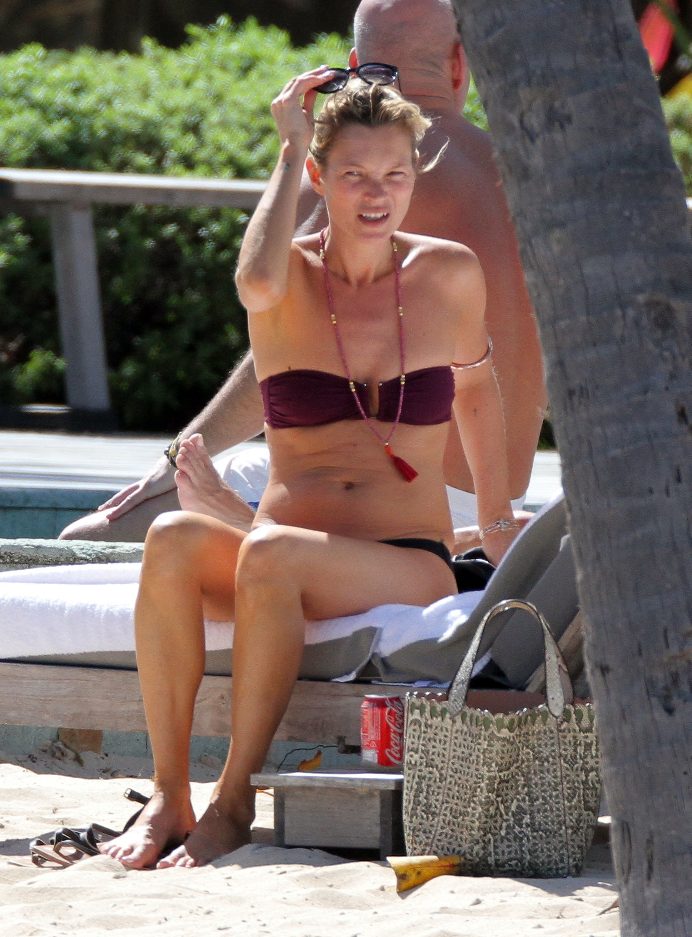 Kate Moss wore a necklace with her bikini.