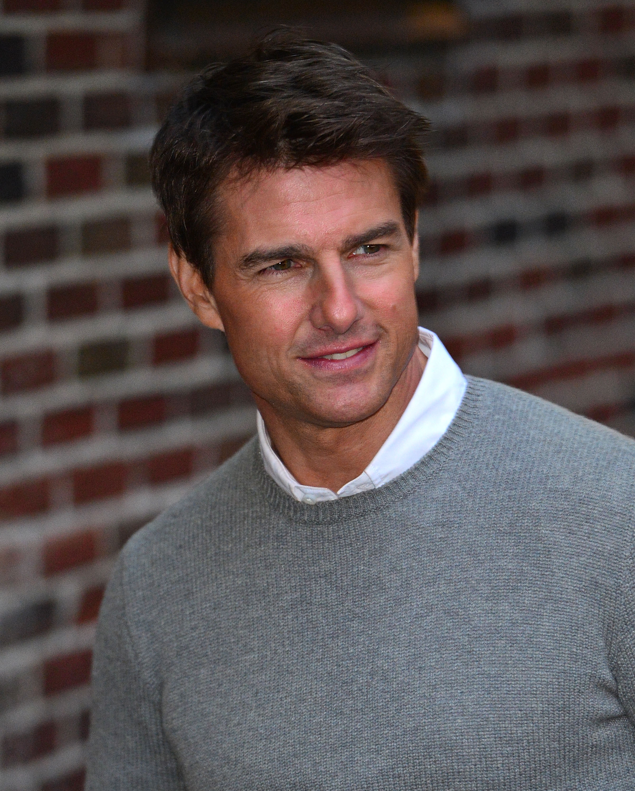 Tom Cruise smiled for photographers.